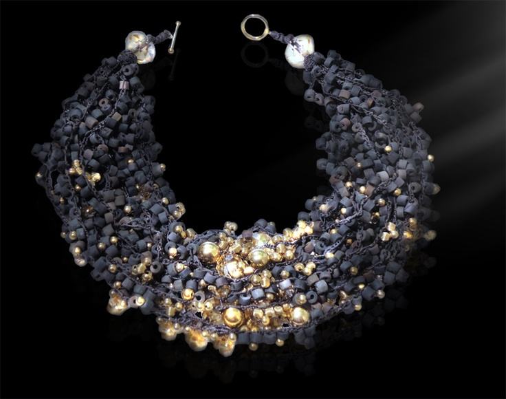 Golden Sun: Let the glittering of this necklace take center stage and certainly lives up to the hype.