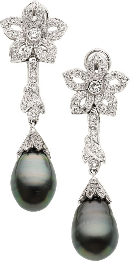 Earrings with black south sea cultured pearls and diamond.