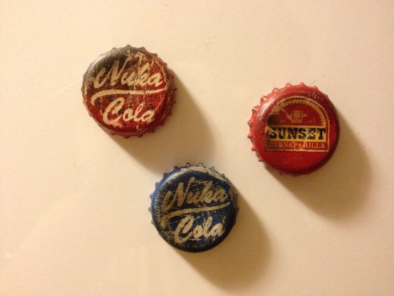 Fallout Bottle Cap Magnets: Nuka-Cola, Nuka-Cola Quantum, and Sunset Sarsaparilla! on Etsy, £2.45:
