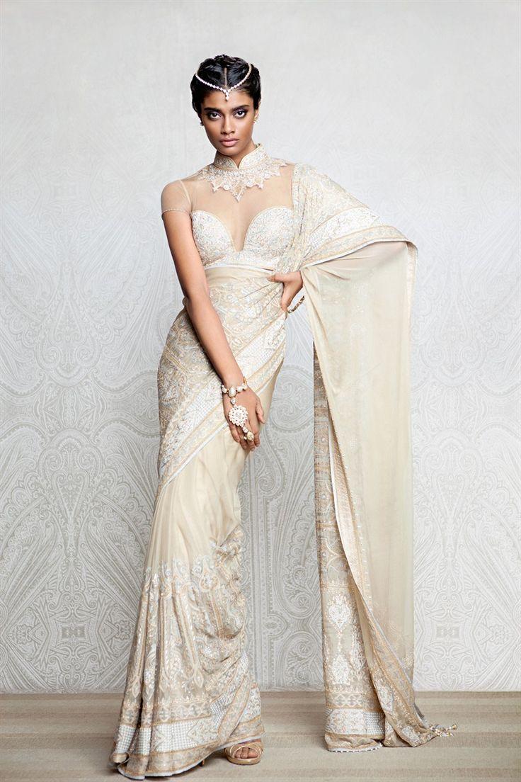 A gold shadow sari embellished with aari work and Swarovski crystals. | Tarun Tahiliani Creation