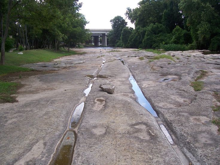 Round Rock, TX : Wagon Tracks along the Chisholm Trail next to Brushy Creek. When it rains, these rocks are under water.