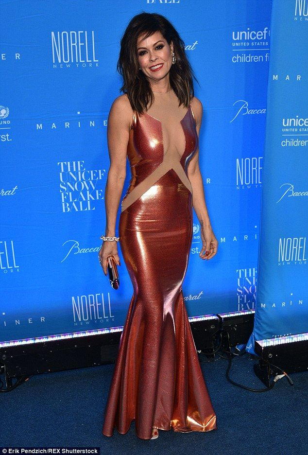 Bronze beauty! Brooke Burke, 44, donned a copper gown with sheer cutouts throughout the fr...