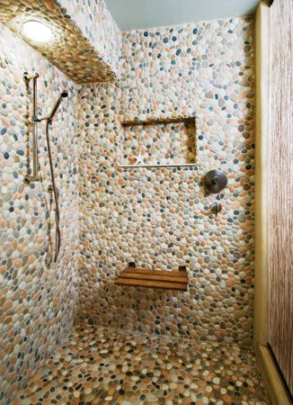 This #shower interior is clad entirely in river rock. #bath #design