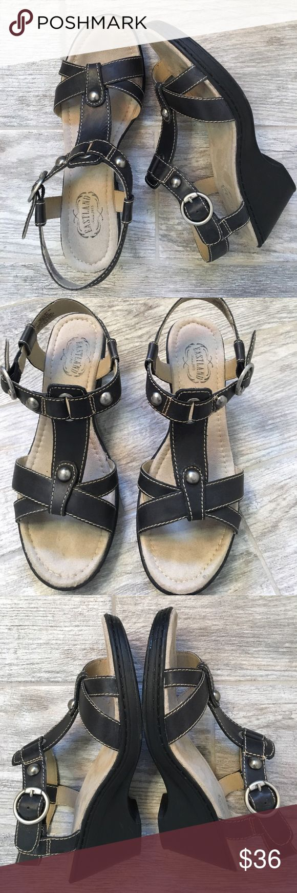 Eastland Wedge Sandals. 8M T-strap sandal, adjustable back strap with silver tone buckle and hardware, very comfortable contoured footbed.  2 1/2 inch graduated wedge.   Hard to find, sold out.  Leather upper. Eastland Shoes Sandals