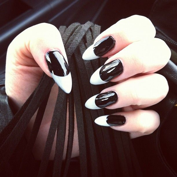love pointy nails- a bit shorter though. def not this extreme but I love the black with white tips  might do red with black tips