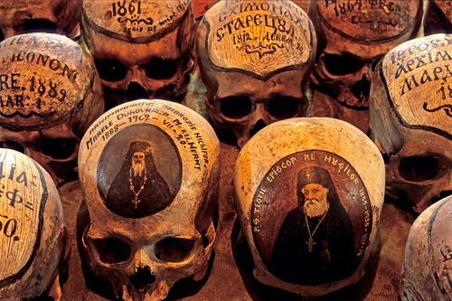 'Dated skulls' and 'Lively skulls.'  by Mick Palarczyk    Some of the skulls in the ossuary of the 15th century (Romanian) Neamt Monastery have little paintings showing their owners in life. Others simply state the names and dates of the monks.