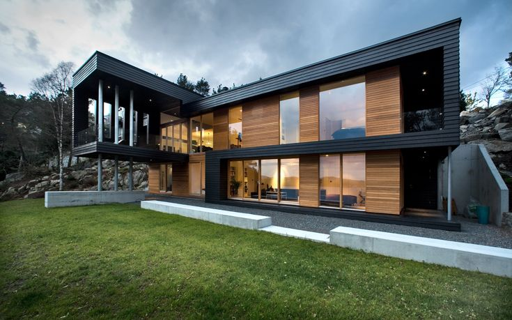This exterior view shows the contrast between the dark stained fir and the warmth of the oiled cedar cladding