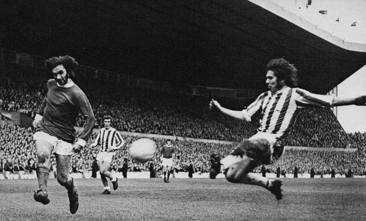 30th January 1971. Huddersfield Town defender Jimmy McGill desperately trying to stop George Best getting in a cross at Old Trafford