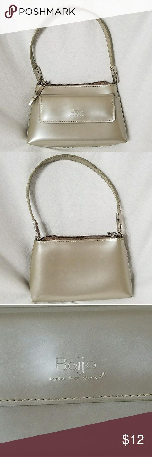 "BEIJO Mini Pearlized Gray Handbag Brand: Beijo  Item: *Very Light Grey Mini Beijo Purse *One Snap Close Pocket on the Front of the Bag *Interior Has One Zippered Pouch *Several Scuffs - As Shown in the Last 2 Pictures, Price Reflects *Removeable Strap *This Would Be a Very Cute Young Girls Bag *Silver Hardware *Measures 6.5""w x 4.5""h x 1""d  *no trades, offers via offer button only* Beijo Bags Mini Bags"
