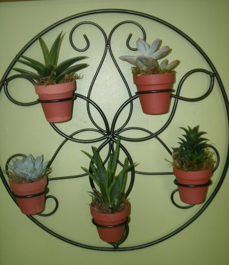 Converted An Old Rod Iron Candle Holder Into A Interesting Wall Garden.  Using Small Clay