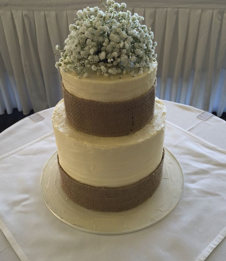 Rustic wedding cake with hessian ribbon and gypsophila cake topper.  www.smalldelights.net.au