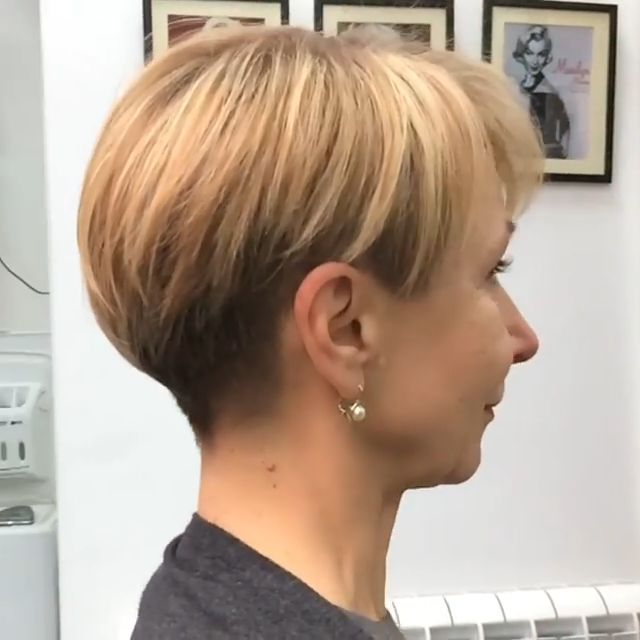 This style suits round faces and heart-shaped faces like the model below. The side-swept fringe covers up a broad forehead and the high wave adds height that makes the face appear longer. With asymmetrical profiles and a neatly highlighted back view, this pixie-cut is full of modern style!