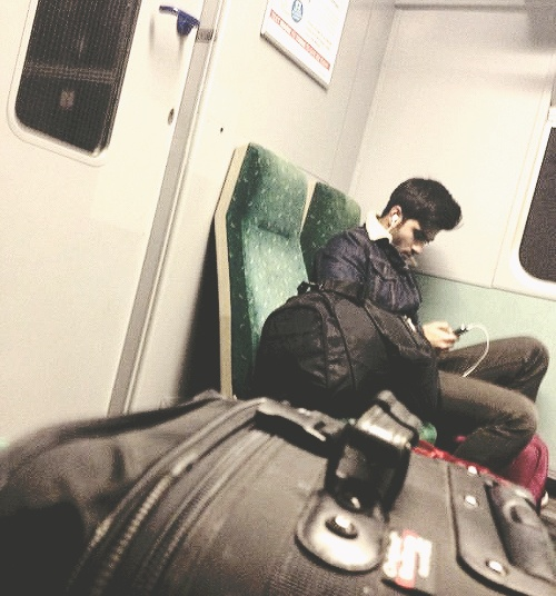 Zayn on a train today. goshhhh he's hot.