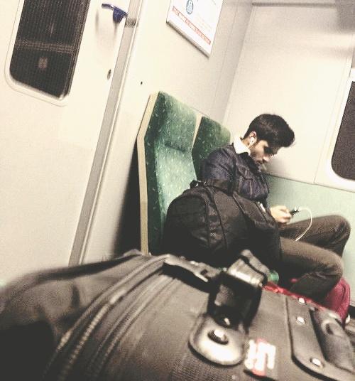 Zayn on a train today. goshhhh he's hot.