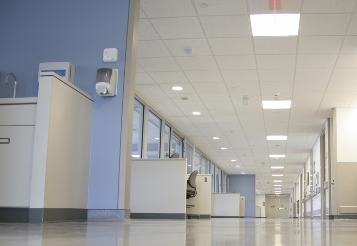Bright white ceiling panels for a hospital corridor helps provide good lighting for patients and staff