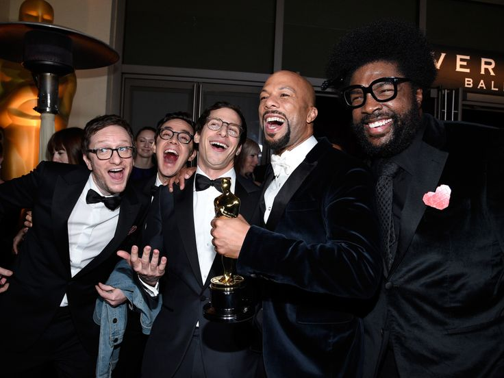 2015 Oscar After-Parties.... Common cheers with Questlove and Lonely Island members Andy Samberg and Akiva Schaffer at the Governors Ball.
