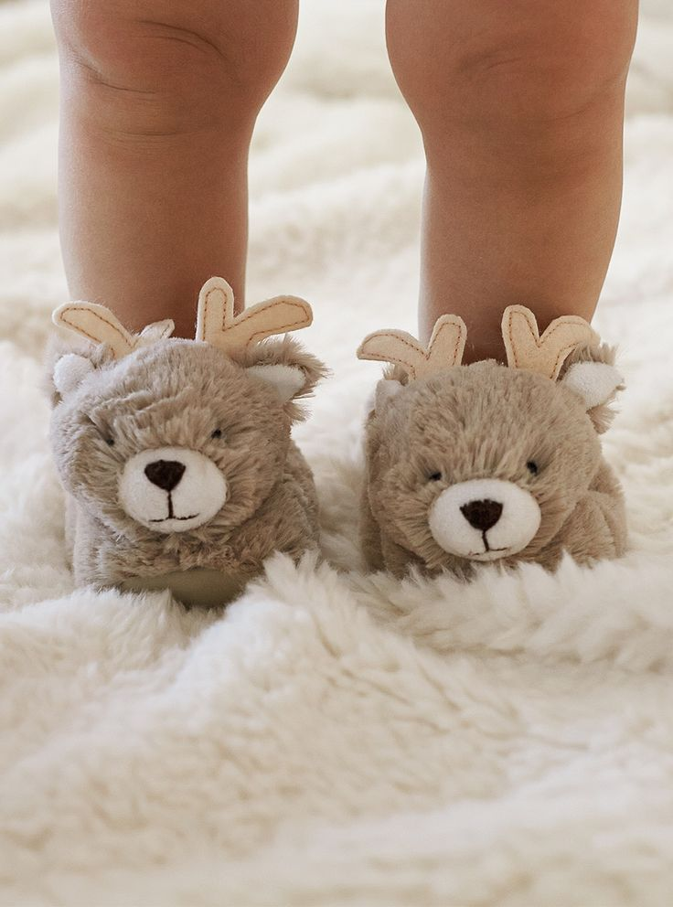 For the newest little addition to the family // Keep little feet warm with this playful set of nursery slippers that features a soft, plush exterior with a sweetly styled reindeer face and antlers.