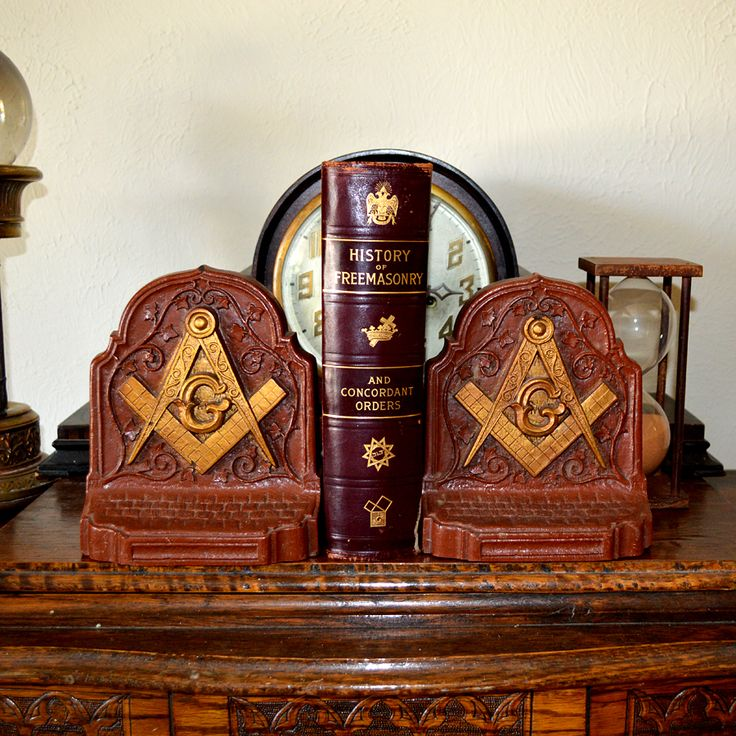"This pair of antique Masonic bookends are fairly large, each weighs nearly 2 lbs. and measures an impressive 6 "" wide x 2 3/8"" deep and stands 7 ¼"" tall. They feature the iconic Square & Compass with the ""G"" at center. Cast from a very dense material with beautiful painting overlay."