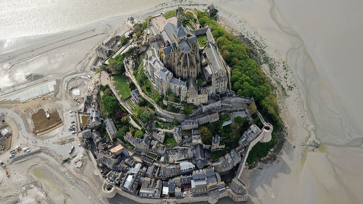 Mont St Michel  -  11 Awesome places to visit during low tide.  An aerial view taken on May 5, 2014 shows the Mont St Michel, northwestern France. The Benedictine Abbey stands on a rocky island in the center of a bay invaded by the largest tides in Europe. (JEAN-SEBASTIEN EVRARD/AFP/Getty Images)