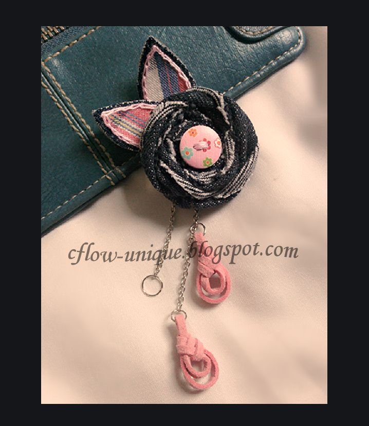 **Pink Suede Brooch** Roses from jeans, and the leaves are made of cotton fabric motifs, combined with studs, chains, and pink leather strap.