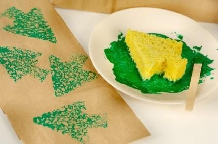 Design your own Christmas wrap with simple paper and sponge shape stampers.  Great craft to do with the kids.