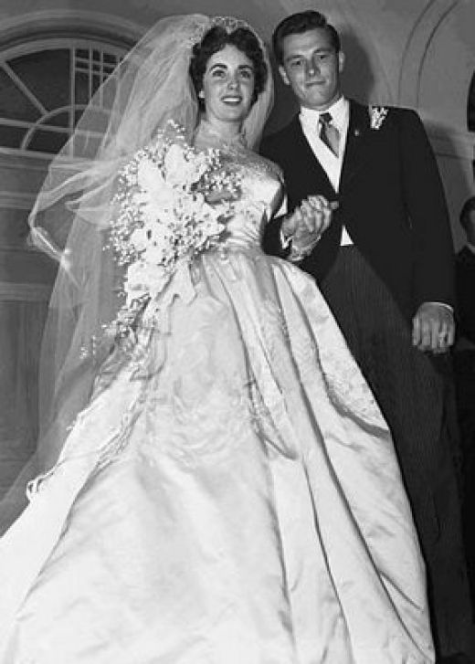 "1950- Elizabeth's first husband was Conrad Nicholson ""Nicky"" Hilton, Jr. was an American socialite, hotel heir, businessman, and TWA director. He was one of the sons of Conrad Hilton.  jj"