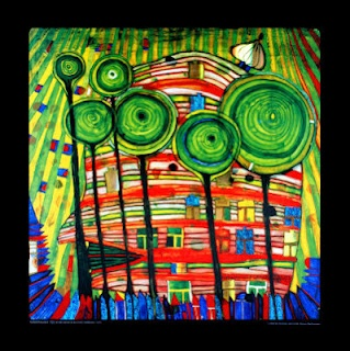 Green trees showcased by a colorful building that lights up the night. Friedensreich Hundertwasser.