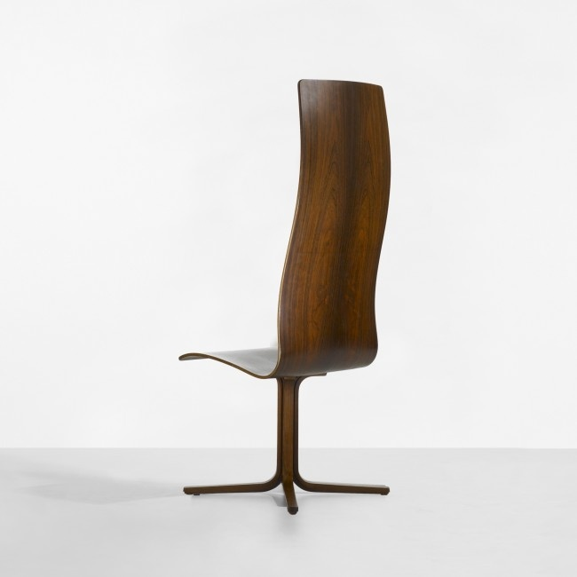 Arne Jacobsen rare Oxford chair for St. Catherine's College  Fritz Hansen  Denmark, 1963  rosewood plywood  18 w x 19 d x 50.5 h inches  This chair was utilized in the dining hall at St. Catherine's College; the high-back seat denotes that this chair was for faculty members on campus. Solid rosewood was used only for this commission and few examples were produced.