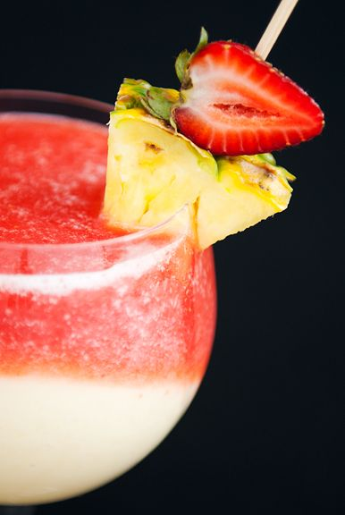 """Holy moly ... pina colado meets strawberry daiquri ..... THIS, my friends ... is called a """"Miami Vice""""  .... ask for it by name, I've NEVER run past a bartender that does NOT know about this drink.  Simple.... 1/2 pina colada & 1/2 strawberry daquiri (we usually top it off with a little Vanilla Rum or Vodka) & of course a fruit skewer.  :o)"""