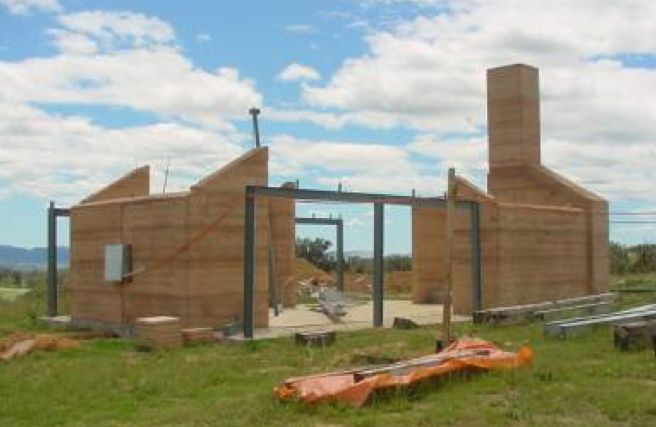 Rammed earth with steel I Beams...  http://www.rammedearthnational.com.au