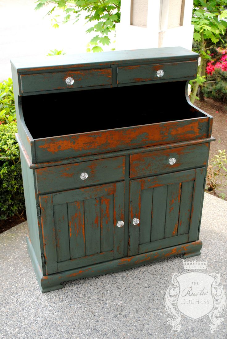 This dry sink was painted in #SweetPickins #MilkPaint.  It is layered with Ocean over Lantern.  It was sealed with Rugger Brown wax and the hardware was updated with new glass knobs.  #ShabbyChic #Painting