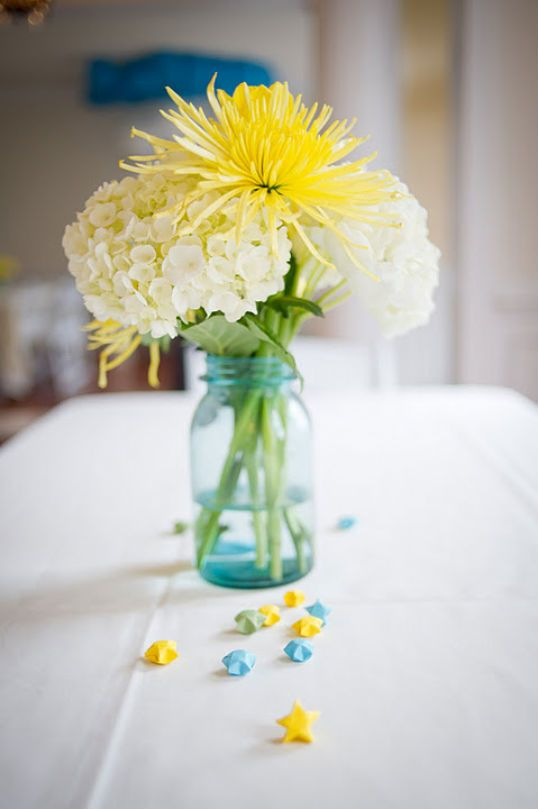 white hydrangea and yellow spider mum with blue mason jar small arrangement for baby