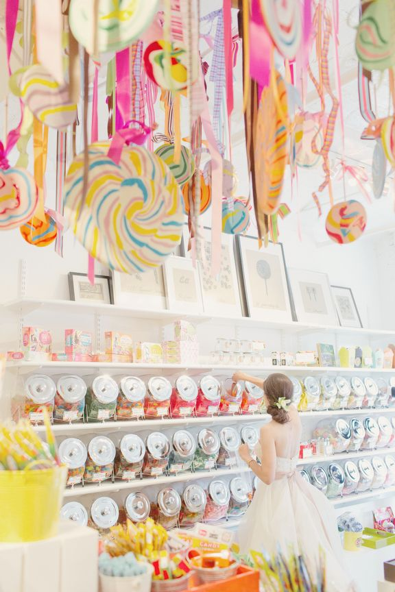 lollipop ceiling display {elisabeth millay}; if you liked the idea, you could hang big lollipops for your photo booth instead of fabric