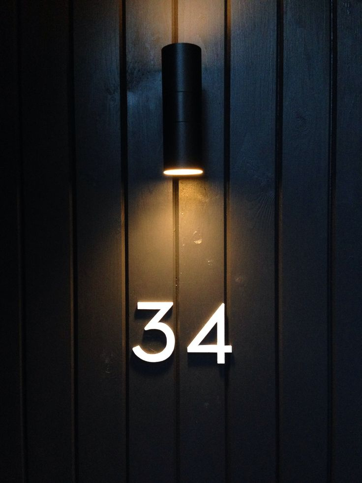 diy painted neutra door numbers. farrow & ball no.2001 strong white on no.57 off-black