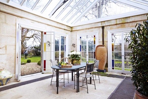 Inside a Grand, Art-Filled Manor in Bath // Conservatory With Stain Glass Windows