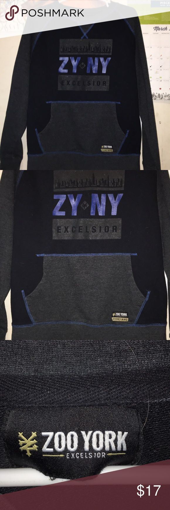 Zoo York Excelsior Designed in NYC sweatshirt Zoo York sweatshirt. Black and gray with blue lettering and stitching. Has a front pocket like a hoodie but it's only a sweatshirt.Excelsior edition. Not sure what size but I'd say it's a medium-large. A little broken in but all the better. Not faded or torn. Still a great shirt!! Zoo York Shirts Sweatshirts & Hoodies