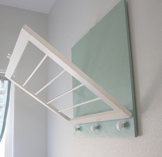 """How to Build a Laundry Room Drying Rack + Supplies: 2 x 2' precut birch (1/2 inch thick) Two 1/2 x 2"""" poplar boards Two 3/8"""" dowel rods (48"""" long) Sash lock Narrow loose pin hinges (set of two) D ring hangers for mounting on wall Bracketed hinge for side (or chain with small screw eyes) Three white porcelain knobs Primer and paint of choice"""