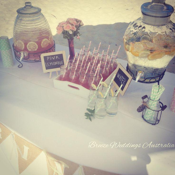 Refreshing drinks for the guests on this hot day:) Home made pink lemonade. Styling by www.breezeweddings.com.au #aimsandshanwa #breezeweddings #drinkstable #wedding #weddingceremony #pinklemonade #milkbottles #lemonade #weddingideas #beachwedding #musthave #happyguests #weddingstylist #идеидлясвадьбы #напитки #лемонад #свадебныйстилист #свадьбанапляже #любимаяработа