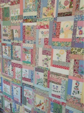 Hen House quilt, I love the scrappy fabrics used, it reminds me of china patterns and tea cups