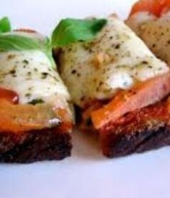 """Cheese Bruschetta is toasted bread seasoned with garlic and cheese. It can be served as an appetizer, snack, or side dish. Generally cheese bruschetta can be served warm so that you can enjoy melted cheese. Bruschetta is an Italian cuisine. The Italian word bruscare means """"roast over coals"""" from this word name bruschetta came. There is lots of different ways to represent the bruschetta."""
