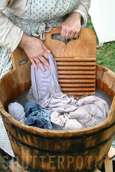 "Hand washing, 18th century style. ""Willa took the idle laundry stick and gave the boiling garments a prod. The day was overcast and cool, but the fire and the rising steam warmed her, dampening the tendrils of hair escaped from her braid."" ~ from BURNING SKY"
