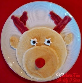Yummy & Fun...Rudolph Pancake Breakfast! We made & used a large pancake for Rudolph's head, and a smaller pancake for his nose, 2 strips of turkey bacon, whipped cream spray (or a marshmallow), 2 chocolate chips, and 1 strawberry. Have Fun Making These & Enjoy! =)
