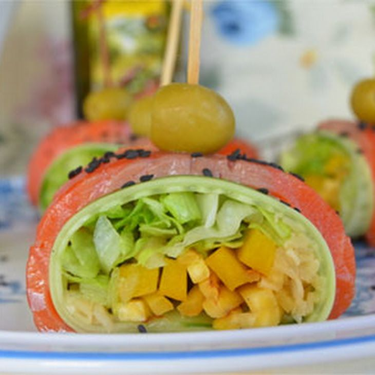 Smoked Salmon Rolls with Vegetables Recipe Appetizers with smoked salmon, yellow turnip, cucumber, iceberg lettuce, yellow bell pepper, gari, green olives, white pepper, olive oil, black sesame seeds