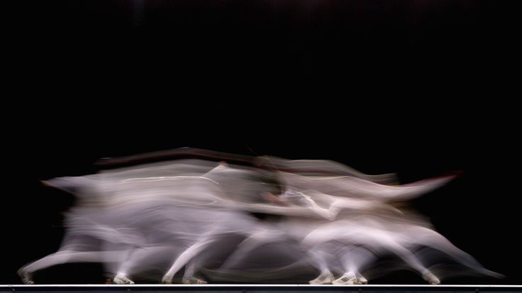 """Alexy Cheremisinov of Russia and Jamie Kenber of Great Britain compete in the Men's Foil Team Final at the Fencing Invitational, part of the """"London Prepares"""" series at ExCel in London, on November 27, 2011. (Dean Mouhtaropoulos/Getty Images)"""