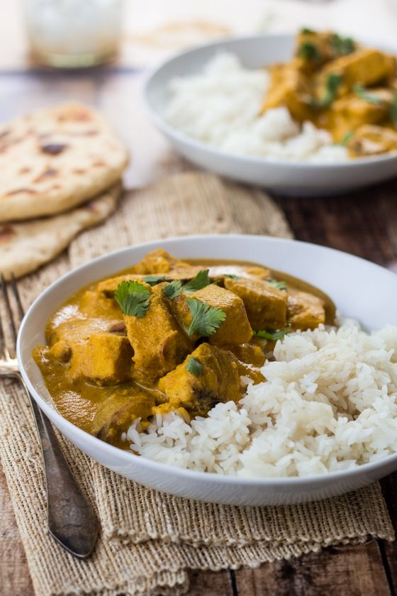 Creamy cashews add a velvety richness to this flavorful Indian Chicken Curry - pair with homemade naan bread for the perfect meal!