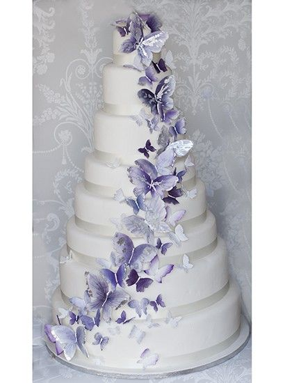 The Liggy's Cake Company - special handmade cakes 8 tiers simply decorated with it all being about that beautifully made lilac and silver tinted cascade of butterflies.