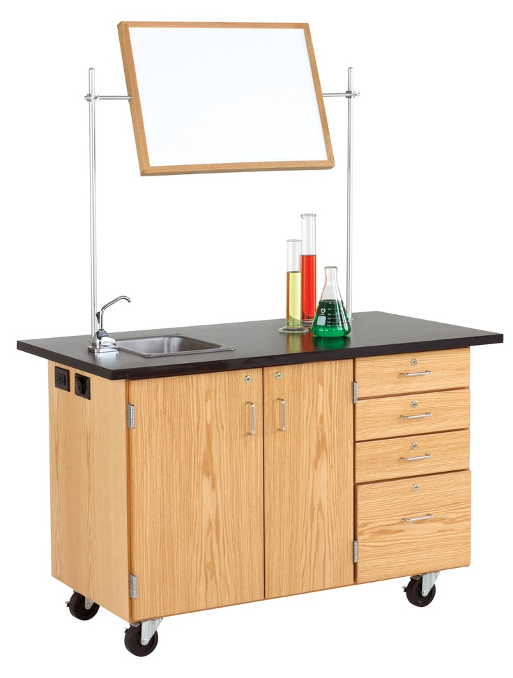 Mobile instructor's desk is equipped with two cupboard compartments, one file drawer, and three smaller drawers. Constructed of oak and oak veneers this unit is equipped with a pegboard with 50 assorted hooks, a wooden tote tray, stainless steel sink, hand pump, water bottles, full upright set, 25' extension cord, and GFI protected AC duplex electrical receptacle. Unit has space to store the mirror/markerboard. All drawers and doors lock. (DW_4342K)