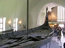 Oseberg Ship in Norway - real Viking ship with dragon head prow