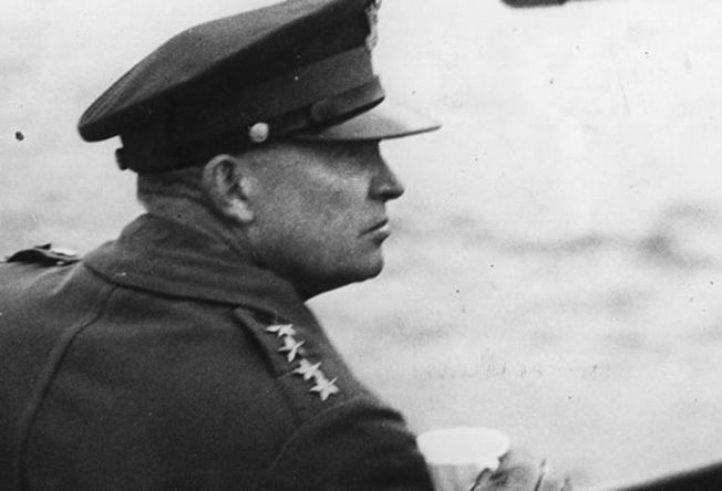 The heavy weight of command is clearly visible on Eisenhower's face as he observes the Normandy invasion beaches on D+1 aboard the British mine layer Apollo. By this time he had already commanded three other major amphibious assaults—the invasions of North Africa, Sicily, and Salerno.