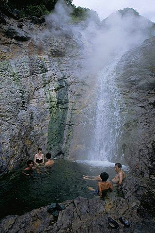 Relaxing in volcanic hot water waterfall, Kamuiwakka-no-taki falls, Shiretoko National Park, Hokkaido, Japan, #japo